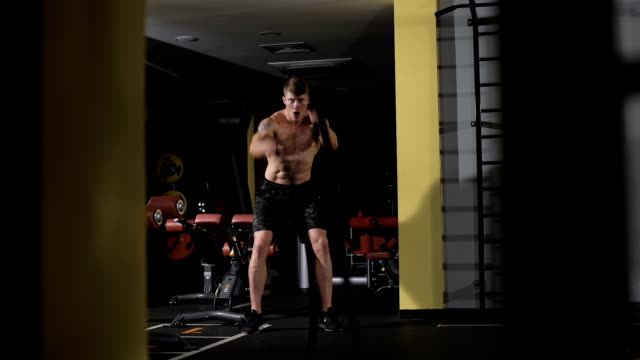 Fitness battling ropes at gym workout fitness exercise video