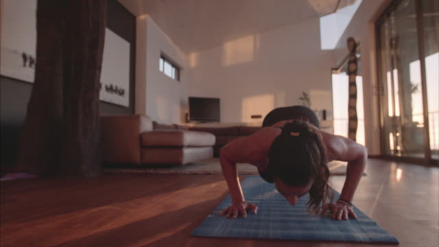 Fitness female doing push ups at home video
