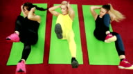 Fitness female doing stretching workout on exercise mat, beautiful girl athlete engaged in exercises Helps her in this her own personal coach video