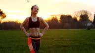 Fitness girl doing twist body exercise video