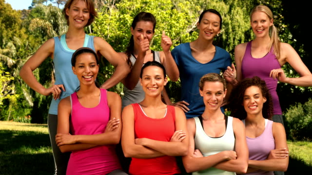 Fitness group smiling at camera in park video