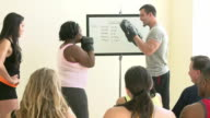 Fitness Instructor In Exercise Class For Overweight People video