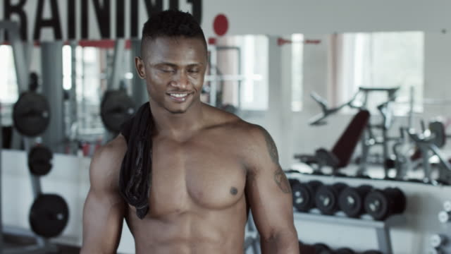 Fitness man aiming gesture and smile video