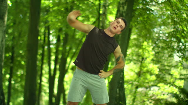 Fitness man doing stretching exercises outdoor. Fitness workout outdoor video