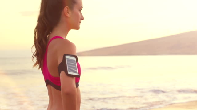 Fitness Model at the Beach. Warm Color Tones. video