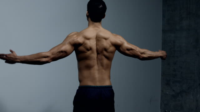 Fitness Model Displaying Back Muscles video