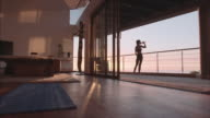 Fitness woman doing stretching in living room video