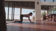 Fitness woman doing stretching work out at home video