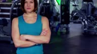 Fitness woman keeps arms crossed on her chest video