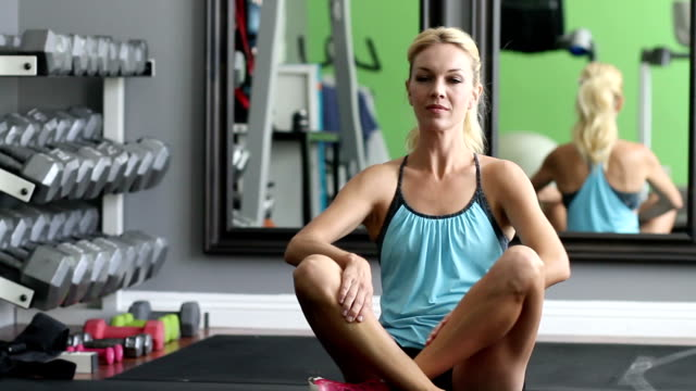 Fitness Woman Stretches Before Workout video