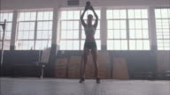 Fitness woman working out with kettle bell at gym video