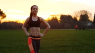 Fitness young woman doing twist body exercise video