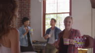 Five happy friends laughing in kitchen, close up, shot on R3D video