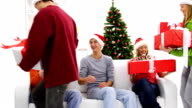 Five happy teenagers with holiday presents. video