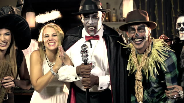 Five multi-ethnic adults at costume party video
