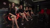 Five women sitting at bar video