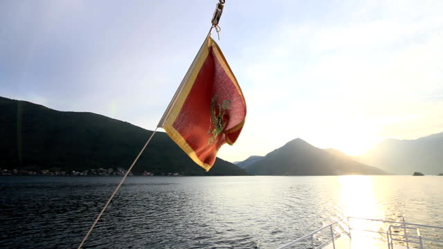 Flag of Montenegro, on the street, in the wind. Montenegro video