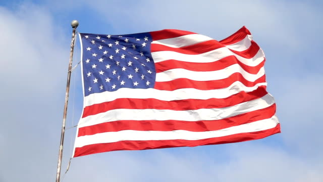 SLOW MOTION USA flag waving in the wind, representing United States of America video