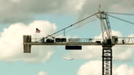 USA flag waving on construction crane video