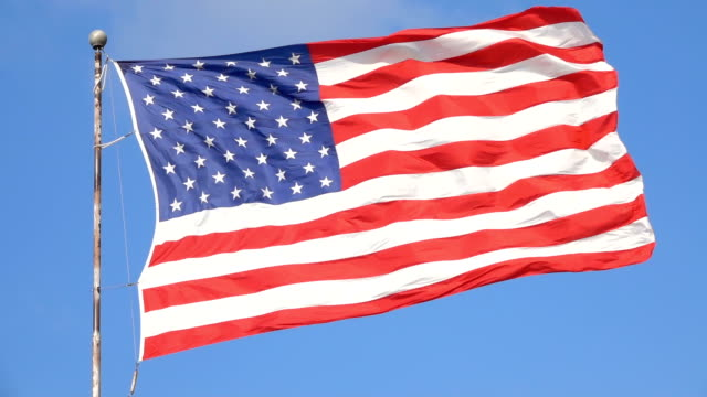 CLOSE UP: USA flag waving proudly, representing United States of America video