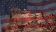 US Flag waving transparent over Mt. Rushmore video