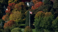 Flagpole with US flag - Aerial View - Massachusetts,  Norfolk County,  United States video