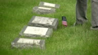 US flags being placed in front of graves video