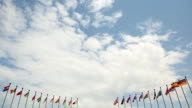 flags on a background of clouds video