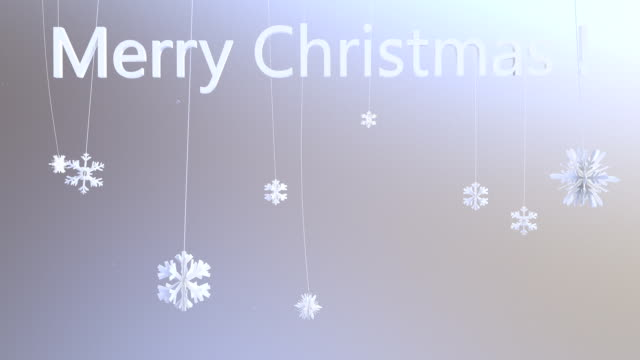 Flakes hanging on strings with Merry Christmas, camera animation video