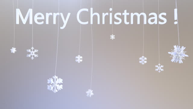 Flakes hanging on strings with Merry Christmas title video