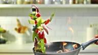 SLO MO TU Flambaying colorful vegetables video