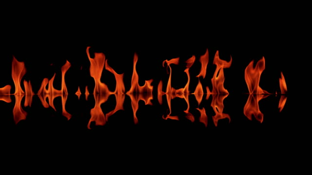 SLO MO Flame tongues on black background video