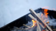 Flames fire eats timber in a brazier standing outside winter video