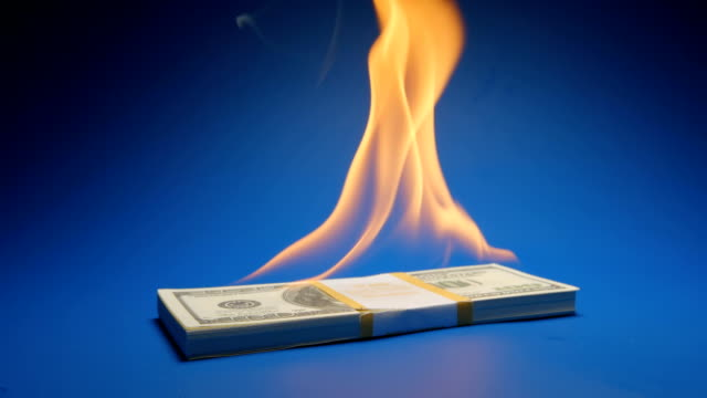 SLOW MOTION: Flaming paper money heap (US dollar) video