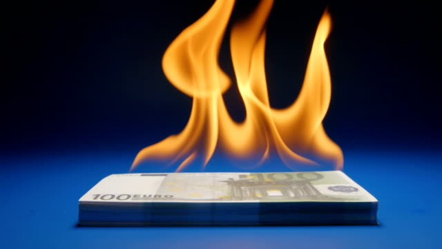 SLOW MOTION: Flaming paper money heap (Euro) video