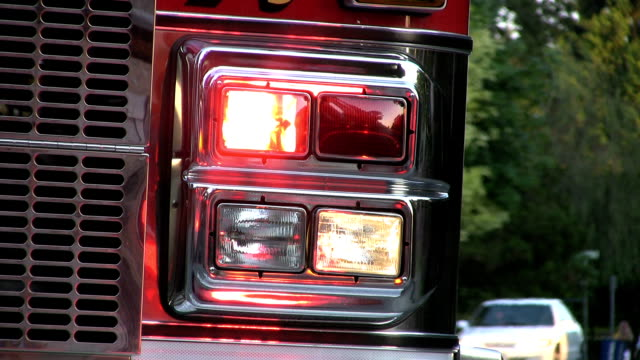 Flashing Lights On Firetruck With Traffic Passing By video