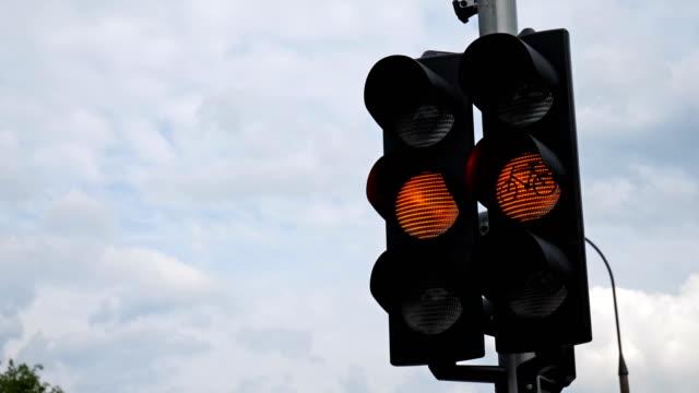 Flashing orange warning light with bicycle sign. video
