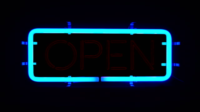 flickering blinking blue neon sign on black background, open shop bar sign video