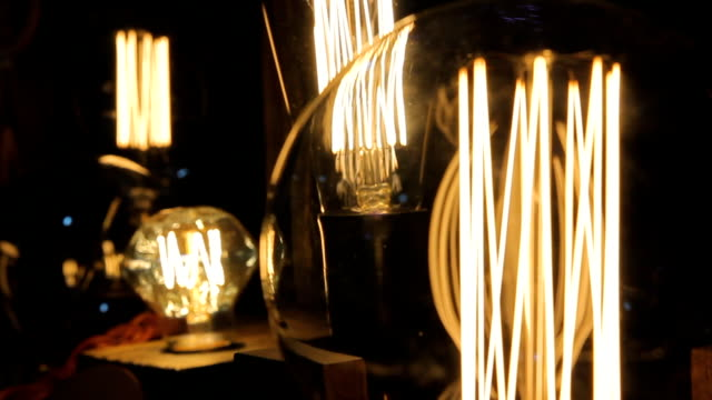 Flickering filament inside decorative Edison light bulbs, design, creativity video