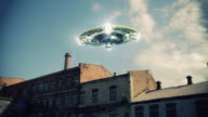 UFO flies over abandoned buildings video