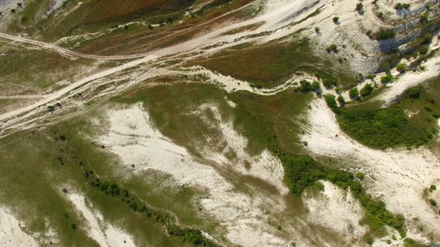 Flight above white rocky mountains with plateaus and canyons, aerial video video