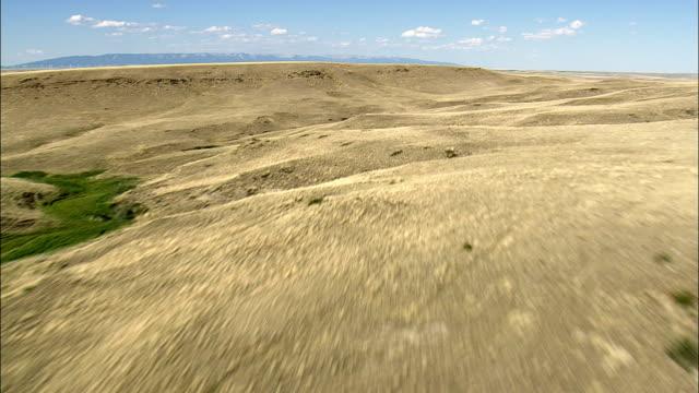 Flight Across Arid Landscape To Harlowton  - Aerial View - Montana, Wheatland County, United States video