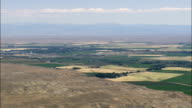Flight And Pan Across Green Ribbon Created By Big Horn River  - Aerial View - Wyoming,  Washakie County,  helicopter filming,  aerial video,  cineflex,  establishing shot,  United States video