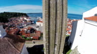 Flight and takeoff over old city Piran, aerial panoramic view video