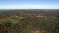 Flight And Track Past Wooded Hill  - Aerial View - New Hampshire,  Cheshire County,  United States video