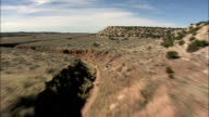 Flight Down Dried Up River Bed  - Aerial View - New Mexico,  Cibola County,  United States video