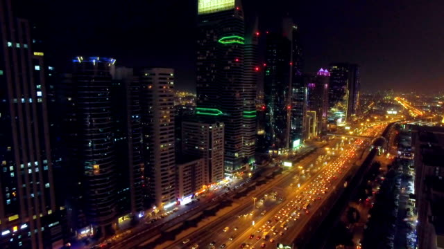 Flight in the night city. Dubai, UAE video