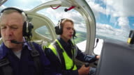 Flight Instructor Mentoring Student on Practice in Air video