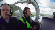 Flight Instructor Teaching Student in Air video