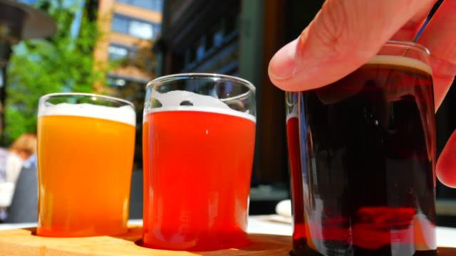 Flight of Craft Beer Samplers, Amber Ale, Grapefruit Saison, Hefeweizen Beer video